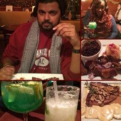 Photo taken at Mojitos Bar & Restaurant by Richard R. on 2/21/2015