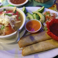 Photo taken at Los Chilaquiles - Bar & Mexican Grill by Teresa C. on 2/22/2013