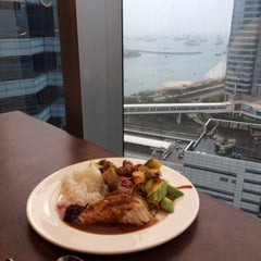 Photo taken at HSBC Centre 匯豐中心 by Jessica C. on 4/23/2014