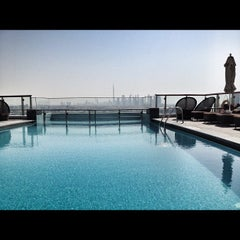 Photo taken at Hilton Dubai Roof Pool by Robert M. on 9/9/2012