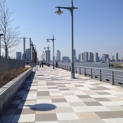 Photo taken at Pier 25 — Hudson River Park by Vic L. on 3/19/2012