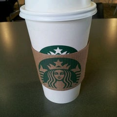 Photo taken at Starbucks by Jessica J. on 3/9/2012