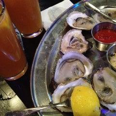 Photo taken at Biggie's Restaurant Raw Bar Tavern by Jenn W. on 11/7/2012