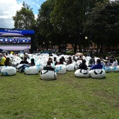 Photo taken at Parque de la 93 by Katha D. on 6/11/2013