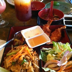 Photo taken at Papaya Thai & Asian BBQ by Mary Rose J. on 10/21/2012