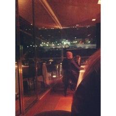 Photo taken at Roof Garden Restaurant by Martina R. on 3/22/2014