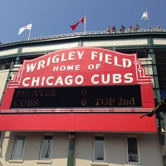 Photo taken at Wrigley Field by Emily S. on 7/5/2013