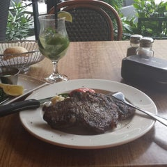 Photo taken at Vieux-Port Steakhouse by Asma H. on 6/4/2014