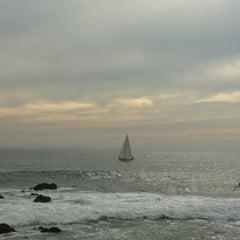 Photo taken at Playa Higuerillas by Sergio R. on 7/6/2013