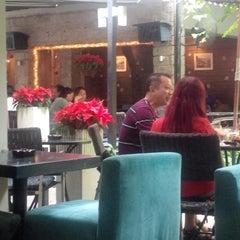 Photo taken at Pergola cafe by Nhu H. on 12/16/2014