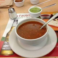 Photo taken at El Farolito by Rene V. on 2/13/2013