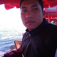 Photo taken at Pantai Penimbangan by Putri E. on 5/22/2014