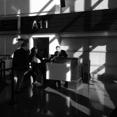 Photo taken at Gate A11 by Kevin R. on 3/17/2015