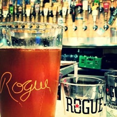 Photo taken at Rogue Ales Public House & Brewery by Ellie Y. on 8/28/2014