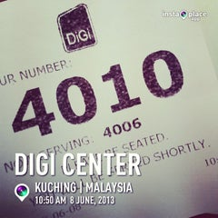 Photo taken at DiGi Store™ by Dwin.L on 6/8/2013