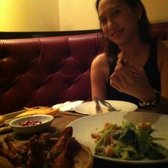 Photo taken at Woodstock Bar & Grill by Eakalux S. on 6/16/2012