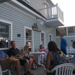 Photo taken at Tugboats Restaurant by Laura G. on 8/5/2014