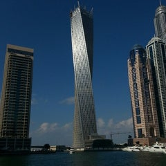 Photo taken at Dubai Marina Walk ممشى مرسى دبي by Burak K. on 1/1/2013