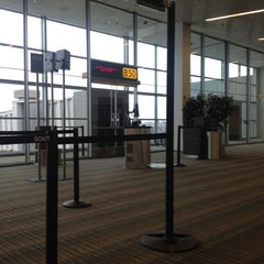 Photo taken at Gate B50 by Millie S. on 12/16/2012