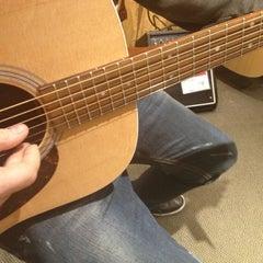 Photo taken at Guitar Center by Cara R. on 12/15/2012