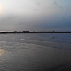 Photo taken at Pantai Marunda by Simas A. on 3/11/2014