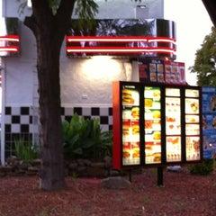 Photo taken at Rally's Hamburgers by Gogogabby007 on 4/18/2012