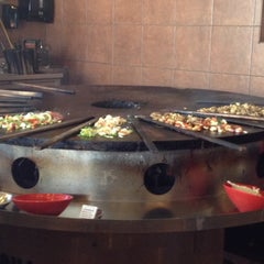 Photo taken at Genghis Grill by Liz M. on 5/18/2012