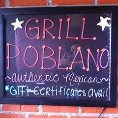 Photo taken at Grill Poblano by Andrew F. on 3/9/2012