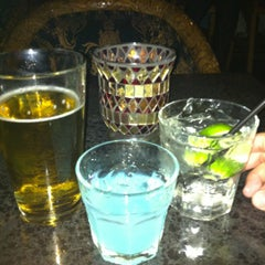 Photo taken at Esquire Bar & Martini Lounge by Melanie P. on 7/15/2012