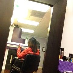 Photo taken at Coils Hair Lounge by Rhonda B. on 2/28/2013