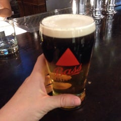 Photo taken at Tigín Irish Pub & Reataurant by Kerry on 3/18/2015