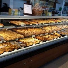 Photo taken at Porto's Bakery & Cafe by Scott T. on 7/19/2013