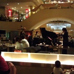 Photo taken at Azie Grand Café by Sylistic on 10/9/2012