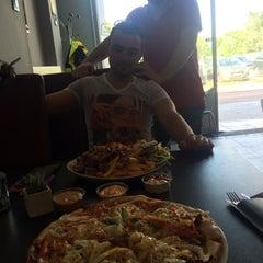 Photo taken at Nazar Kebab & Pizza by Cuneyt H. on 6/15/2015