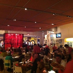 Photo taken at Wolfgang Puck Bar & Grill by Carlos Alberto P. on 5/27/2013