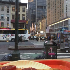 Photo taken at A Slice of New York by Mariana A. on 3/25/2015