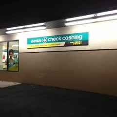 Photo taken at Davids Check Cashing by Matthew C. on 12/20/2012