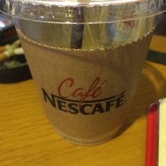 Photo taken at Café NESCAFÉ by Allen R. on 9/27/2014