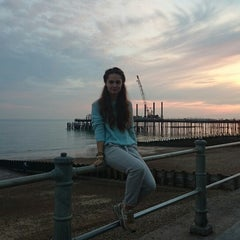 Photo taken at Hastings Pier by Jekaterina D. on 9/28/2014