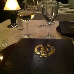 Photo taken at Delmonico's Restaurant Steak House Grill by Jane L. on 3/5/2013