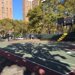 Photo taken at Rucker Park Basketball Courts by Gokhan A. on 10/30/2014
