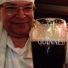 Photo taken at Tigín Irish Pub and Restaurant by Bob T. on 9/6/2015