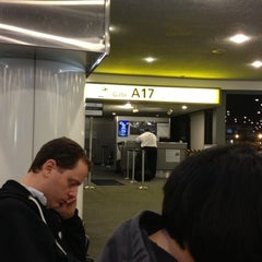 Photo taken at Gate A17 by Emily E. on 10/16/2012