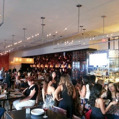 Photo taken at Wolfgang Puck Bar & Grill by Andrew O. on 6/29/2013