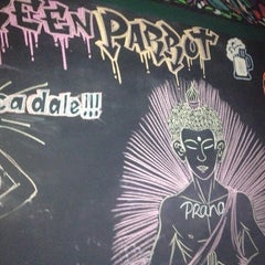 Photo taken at Green Parrot Ride Bar & Shop by Micaela M. on 7/13/2013