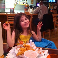 Photo taken at Hooters by Gregory H. on 12/24/2011