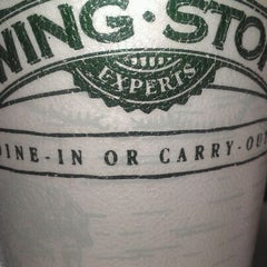Photo taken at Wingstop by Tre G. on 3/13/2012