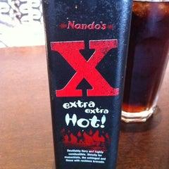 Photo taken at Nando's by Benjy M. on 6/3/2012