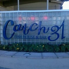 Photo taken at Catch 31 Fish House and Bar by Ronnie C. on 1/1/2012