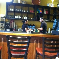 Photo taken at Bella's Cafe by Mike B. on 6/2/2012